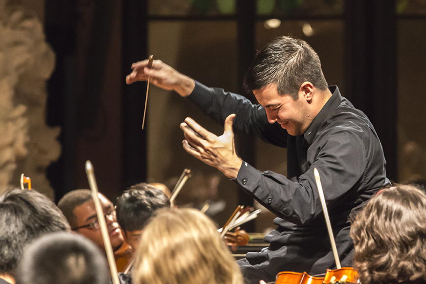 Male conductor conducting
