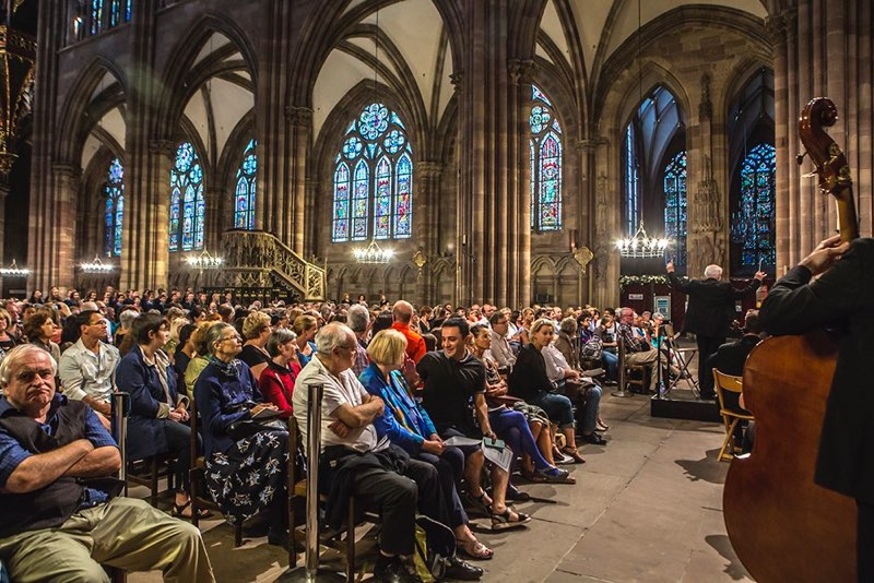 Orchestra performing to full cathedral audience