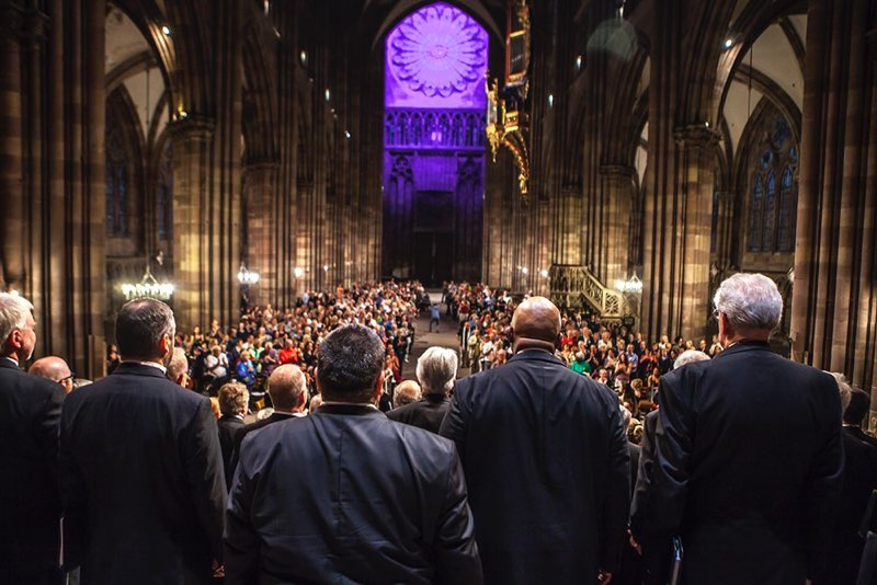 Adult choral society performing to full cathedral
