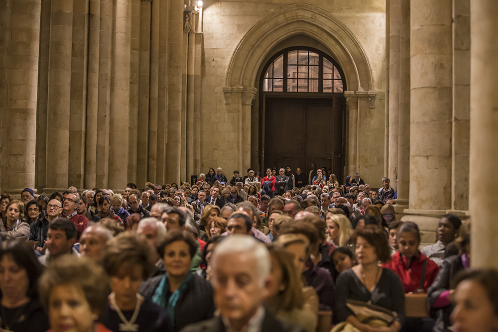 Perspective photo of audience, full and standing audience in cathedral