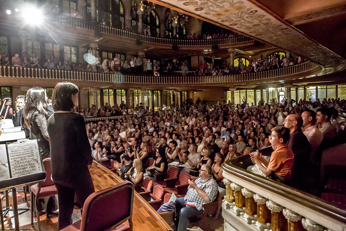 Orchestra recieving applause from full audience in the Palau in Barcelona
