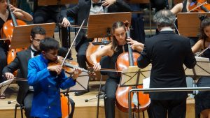 Violin soloist playing with orchestra