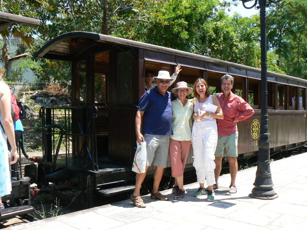 ACFEA courier Dragana with tour members on a train platform
