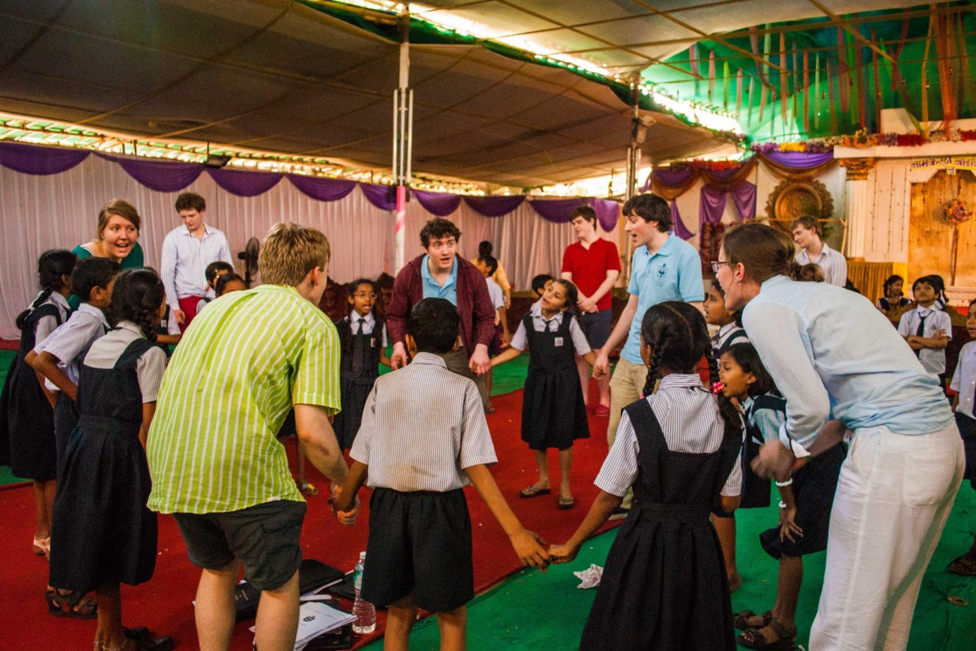Tour members working with local students in India